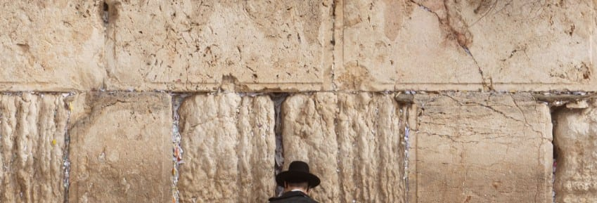 Jewish man praying on the Wailing Wall in Jerusalem
